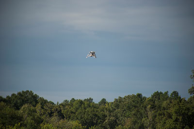 The 'Mighty Eagle' soars above the tree line. The vehicle was 'open loop' -- navigating autonomously without the command of the onboard camera and flying on a preprogrammed flight profile.