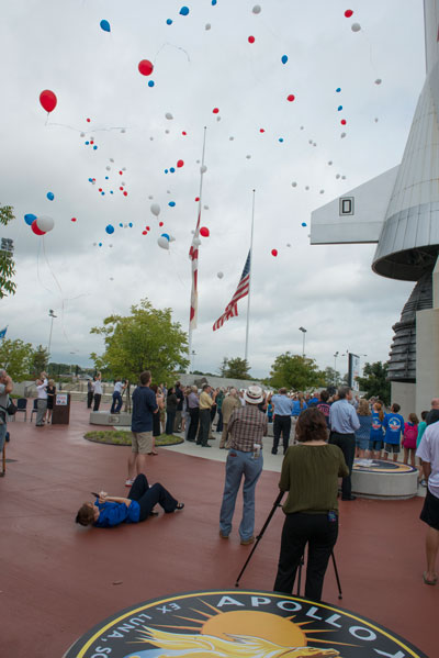 A large group gathered near the life-size model of the Saturn V rocket at the U.S. Space & Rocket Center and released red, white and blue balloons at a memorial to celebrate the life of former astronaut Neil Armstrong. In honor of Armstrong, flags flew at half-mast across America on Aug. 31.