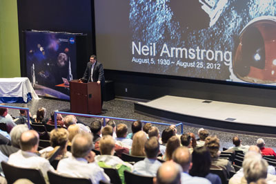 Space Launch System Program Manager Todd May takes a moment to honor the memory of former astronaut Neil Armstrong during a short presentation to the SLS team at the SLS Awards Breakfast on Aug. 28 at the U.S. Space & Rocket Center's Davidson Center for Space Exploration.