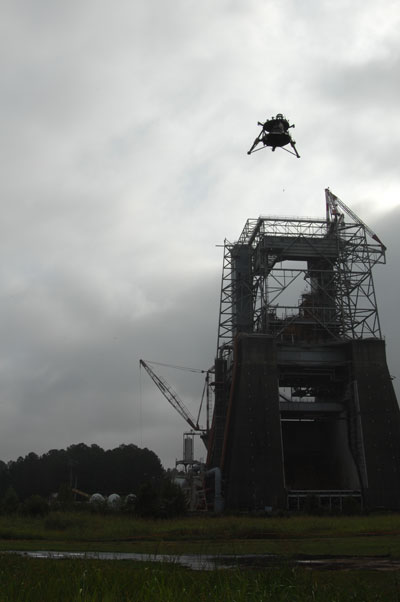 Overcast skies didn't deter the 'Mighty Eagle,' flying high above the historic F-1 test stand -- formerly used to test turbopumps for Saturn first stage engines.