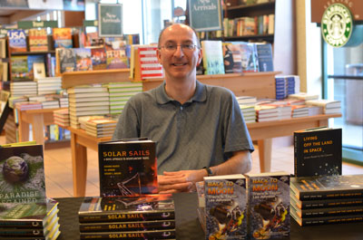 Les Johnson participates in a book signing at Barnes & Noble in Lexington, Ky., in March.