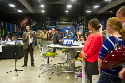 Marshall Center Chief Technologist Andrew Keys welcomes guests as he officially kicks off the technology expo in Building 4316.