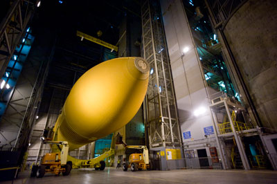 External Tank 94 inside the Vehicle Assembly Building at the Michoud Assembly Facility. The Manufacturing Support and Facility Operations Contract team lifted the large structure, which was standing in the vertical position, and gently placed it horizontally into it's wheeled carrier Sept. 15.