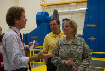 The U.S. Army Materiel Command's new deputy commanding general, Lt. Gen. Patricia McQuistion, right, tours the Marshall Space Flight Center with her husband retired Army Col. Leif Johnson, center, on Sept. 18.