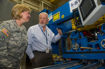 Lt. Gen. Patricia McQuistion, left, visiting the South High Bay of Building 4755, listens to Tim Vaughn, a metallic materials aerospace engineer in the Engineering Directorate, as he explains the Marshall Center's friction stir welding capabilities.