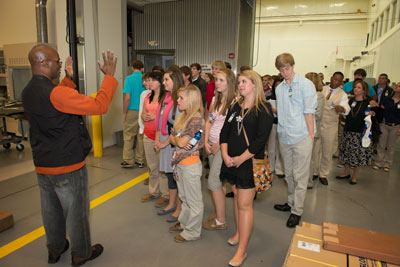 Left, Marshall Center engineer Johnnie Clark explains rapid prototyping technologies to the students in the National Center for Advanced Manufacturing, during the 12th annual Adventures in Engineering Career Day.