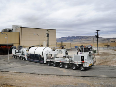 The forward segment of the qualification motor for the Space Launch System is transported through manufacturing and assembly at ATK's facility in Promontory, Utah, in preparation for a full-scale ground test there next spring.