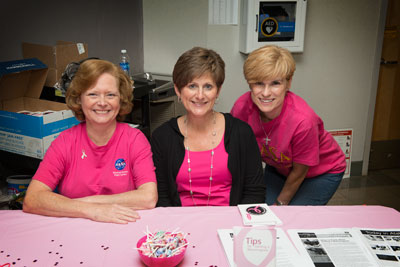 Cindy Stemple, center, Donna Mahieux, left, and Tricia Motts, right, work to raise awareness at the Oct. 11 Breast Cancer Awareness Month event at Marshall.