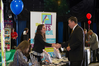 Newly appointed Marshall Center Director Patrick Scheuermann, left, greets a representative from The Arts Council Inc.
