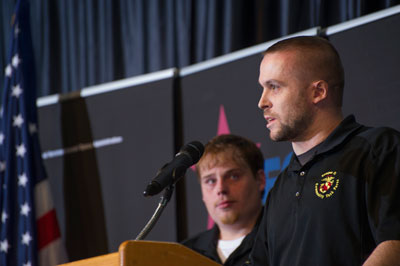 James West, at the podium, and Brandon Johnson, left, both soldiers who were severely wounded during active military duty, shared their stories of hope and how the organization, the Wounded Warrior Project, which receives funding from CFC contributions, is helping them through their recoveries.