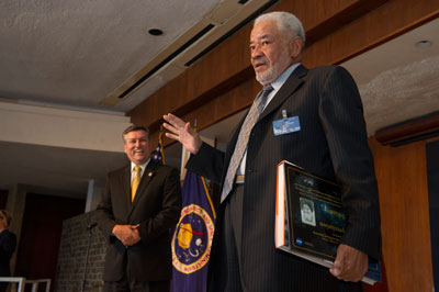Bill Withers, right, accepts mementos of appreciation from Marshall Space Flight Center Director Patrick Scheuermann after delivering a meaningful -- and humorous -- speech at the center's Disability Employment Awareness Month program Oct. 11.