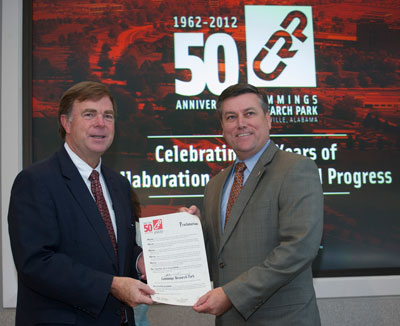 Huntsville Mayor Tommy Battle, left, and Marshall Center Director Patrick Scheuermann display the Cummings Research Park Proclamation during the park's 50th anniversary celebration.