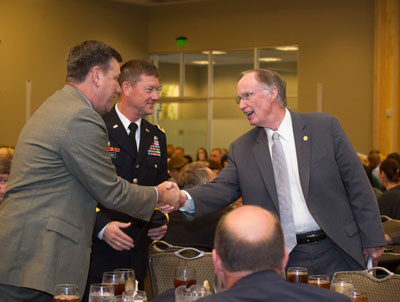 Alabama Gov. Robert Bentley, right, congratulates Marshall Center Director Patrick Scheuermann, left, and U.S. Army Maj. Gen. Lynn Collyar, commanding general of the U.S. Army Aviation & Missile Command, for a successful 50 years of mission success and collaboration in the Huntsville community.