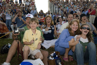 Emmett Given captures one of his most memorable Marshall photos during the STS-117 launch in June 2007. The Hutt family of Madison shared a special moment with thousands of other viewers as they witnessed -- and felt -- space shuttle Atlantis's thunderous lift off at Kennedy Space Center.