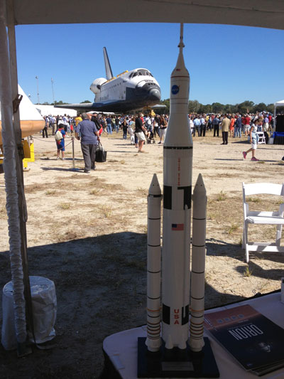 A 6-foot-tall model of NASA's Space Launch System -- which is managed at the Marshall Space Flight Center -- stands near the space shuttle Atlantis as the orbiter makes its final voyage on Nov. 2.