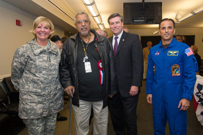From left are Lt. Gen. Patricia McQuistion, U.S. Army Materiel Command's deputy commanding general; Marshall systems engineer Jerry Shelby, a retired U.S. Marine Corps lance corporal; Marshall Center Director Patrick Scheuermann; and NASA astronaut Joe Acaba.