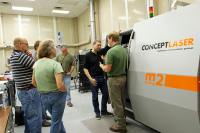 Engineers in the Rapid Protoyping Department in Building 4707 at the Marshall Space Flight Center are learning how to operate the new Selective Laser Melting machine, which will be used to build parts for NASA's Space Launch System.