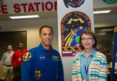 Linda Gibson, right, a payload planning manager with Teledyne Brown Engineering in NASA's Payload Operations Center at the Marshall Center, visits with Expedition 31/32 astronaut Joe Acaba during his visit to the center Nov. 7.
