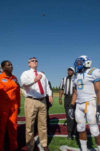 Marshall Space Flight Center Director Patrick Scheuermann, second from left, carries on the long Marshall tradition of tossing the opening coin at the Alabama A&M University High School Senior/NASA Day football game Nov. 3.