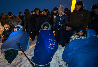 Expedition 33 Commander Sunita Williams of NASA, right, and Flight Engineers Yuri Malenchenko of the Russian Federal Space Agency and Akihiko Hoshide of Japan Aerospace Exploration Agency, left, sit in chairs outside their Soyuz capsule just minutes after they landed.