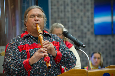 In celebration of Native American Heritage Month, Jimmy Yellowhorse, a performer and member of the Cherokee tribe, plays the flute during a lunch and learn activity Nov. 13 at the Marshall Space Flight Center. The event featured traditional Native American dancing and music.