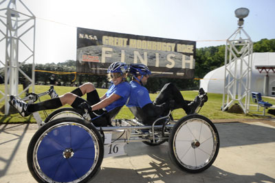 The team from the University of Alabama in Huntsville race to first place in the college division of the 19th annual NASA Great Moonbuggy Race in April 2012.