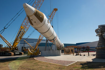 On Nov. 13, cranes lifted a solid rocket booster, with parts flown on more than 30 shuttle missions, into its final position in the Building 4205 propulsion park that can be visited by Marshall team members and visitors.