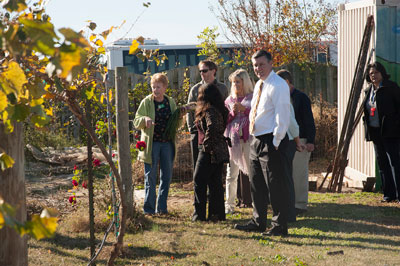 Marshall team members, including Marshall Center Director Patrick Scheuermann, in the foreground, check out the CASA Community Garden.