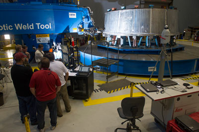 Engineers at the Marshall Space Flight Center conduct their first circumferential weld of the 'pathfinder' version of the adapter design that will be used on test flights of the Orion spacecraft and the Space Launch System or SLS.