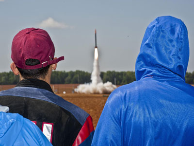 Students watch a rocket lift off at the NASA Student Launch Projects' spring 2012 launchfest at Bragg Farms in Toney, Ala.
