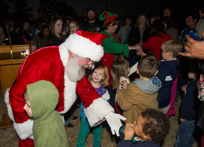 Santa and one of his merry elves hand out candy canes to children at the Marshall Space Flight Center's rocket-lighting ceremony Nov. 30.