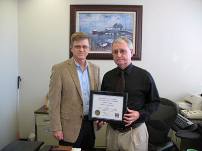 Small Business Specialist David Brock, right, of the Marshall Space Flight Center's Office of Procurement, recently accepted the Employee of the Year award from Tim Strickley, chairperson for the Huntsville Area Governor's Committee on Employment of People with Disabilities.