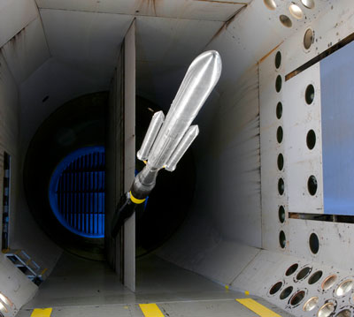 NASA's Space Launch System buffet model in the Langley Researcher Center's Transonic Dynamics Tunnel. The SLS is America's next heavy-lift launch vehicle that will provide an entirely new capability for science and human exploration beyond Earth's orbit.