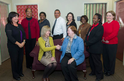 Deputy Director Teresa Vanhooser, seated at left, congratulates Susan Cloud, seated at right, acting director of Marshall's Office of Diversity & Equal Opportunity, and members of her team for being the first organization to reach 100 percent on participation for the Combined Federal Campaign.
