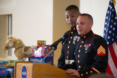 At the recent Marshall Association meeting, Marines from the local chapter of Toys for Tots picked up more than 70 toys to give to needy children in the community.