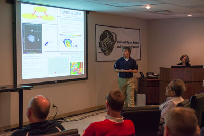Chris Schultz, a NASA cooperative education student in the Science & Technology Office, presents his work Nov. 30 during the sixth annual Science & Technology Jamboree.