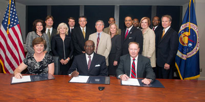 Marshall Center management and representatives from Pratt & Whitney Rocketdyne and Alabama A&M University met July 12 at Building 4200 to sign a two-year Mentor-Prot�g� agreement.