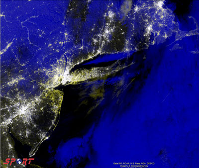 Composite data gathered Nov. 1 depicts urban regions of New York and New Jersey, hard-hit by Hurricane Sandy. Yellow regions indicate high-population centers which had electric power before the hurricane hit but not in its wake; blue regions represent cloud cover.