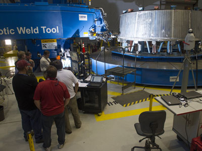 Engineers at the Marshall Center conduct their first circumferential weld of the pathfinder version of the adapter design that will be used on test flights of the Orion spacecraft and SLS. The adapter eventually will connect the Orion spacecraft to the propulsion elements of the rocket.