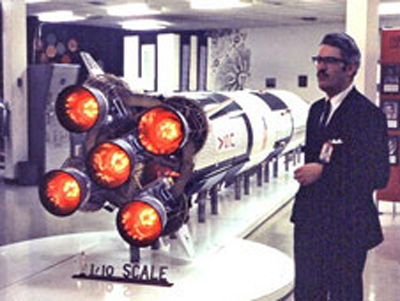 Jesco von Puttkamer, technical manager for ISS, stands beside a model of the Saturn V rocket in this image taken in 1969.