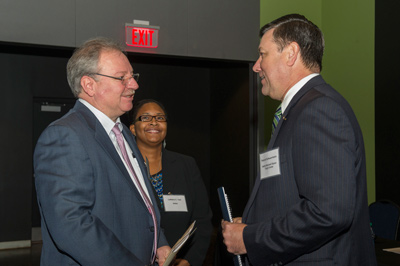 From left, John Vickers talks with Dr. LaNetra C. Tate and Patrick Scheuermann at the National Network for Manufacturing Innovation workshop.