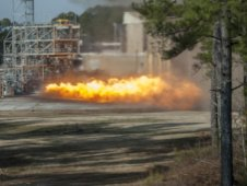 A gas generator from an F1 engine is test fired at the Marshall Space Flight Center