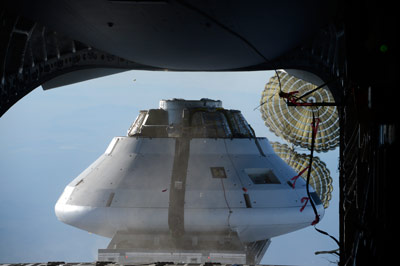 A mockup Orion capsule is poised to drop from a plane 25,000 feet above the U.S. Army Yuma Proving Ground in Arizona to test the parachute design for the spacecraft that will take humans farther than they've ever been before. The test was successfully completed on Feb. 12.