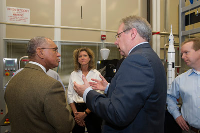From left, NASA Administrator Charles Bolden listens to Nancy Tolliver, John Vickers, and Rob Black as they brief him on the use of 3-D printing and prototyping technology to create parts for the Space Launch System.
