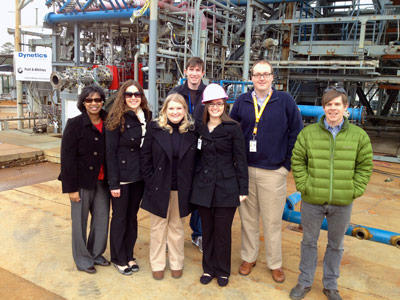Marshall's F-1 engine gas generator test team poses with Butler High School student Caroline Hernandez, center in hardhat, in front of a test stand during her visit to Marshall as part of the WAAY-31 TV news series 'We Are the Future.'