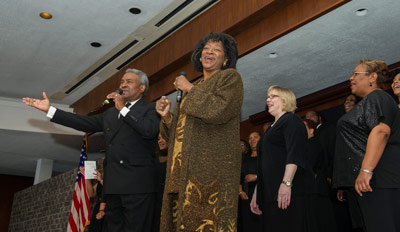 Stewart, front right, sings a song with the Voices of Marshall chorus at the Black History Month observance program. The chorus performed throughout the event.