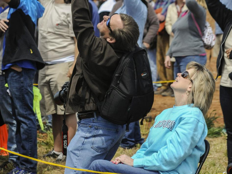 Hundreds of spectators -- including Marshall Center Deputy Director Teresa Vanhooser, seated, and her husband, Mike Vanhooser, left -- kept their eyes to the skies and cheered on their favorite teams at the 2012-13 NASA Student Launch Projects challenge.