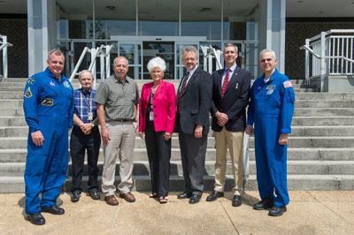 Astronauts T.J. Creamer, far left, and Lee Morin, far right, along with Marshall Deputy Director Teresa Vanhooser, honored 19 team members with Silver Snoopy awards on May 16. The honorees are, from left, Richard T. Weaver, Timothy R. Jett, Brenda B. Wade, W. Steve Spearman and Robert J. Hoffman.