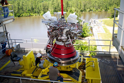 Engineers install J-2X engine E10002 in the A-1 test stand at NASA's Stennis Space Center. The installation is in preparation for a new series of tests, where the engine will be gimbaled, or pivoted, during test firings.