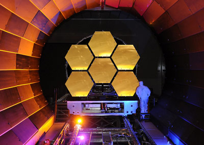 Ball engineer examines six of the 18 JWST mirror segments after a test in MSFC's XRCF facility.